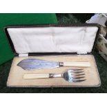 Boxed set of bone handled fish servers and 2 brass iron handled saucepans