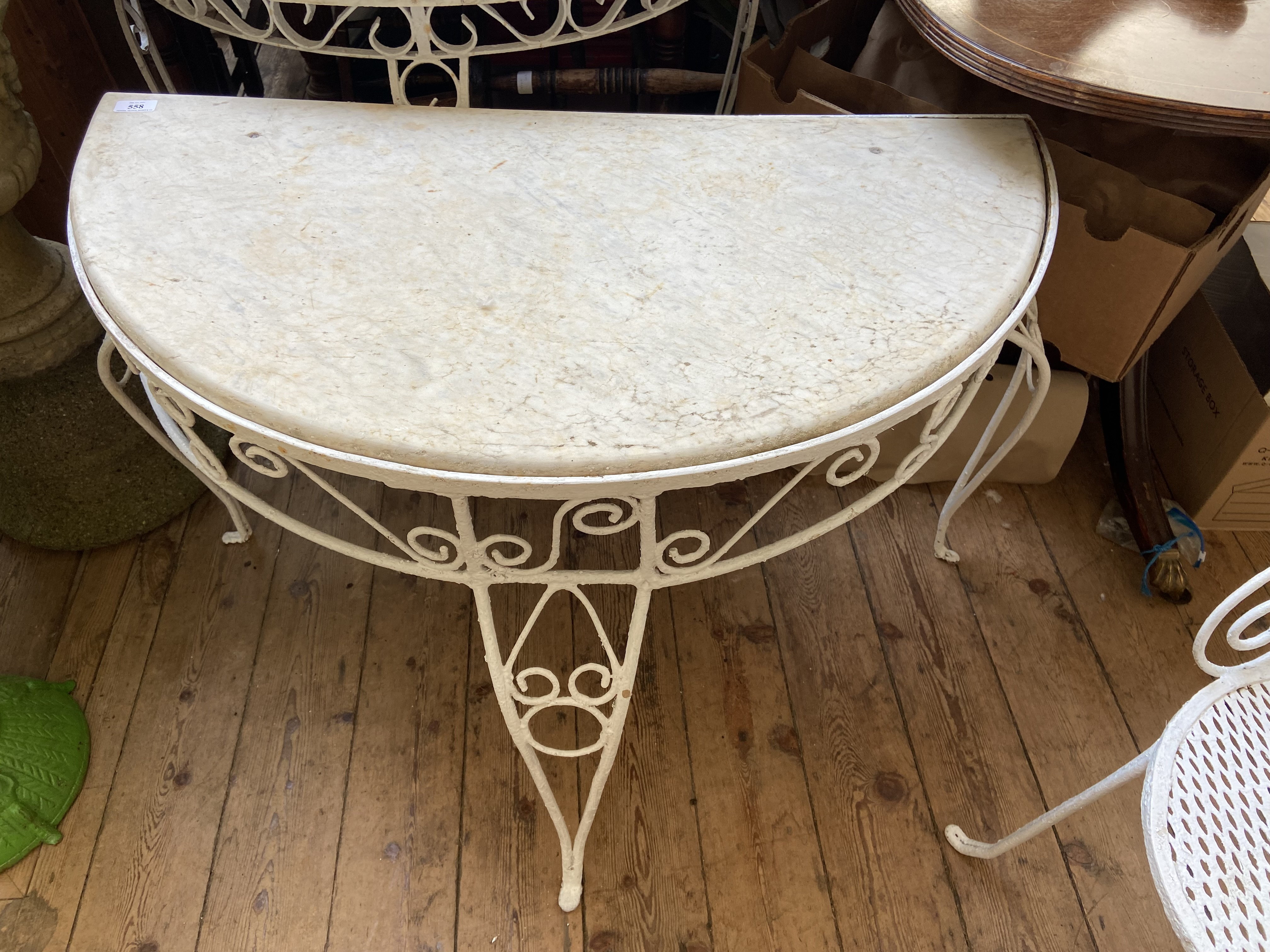 Wrought iron semi-circular garden table inset mottled white marble top