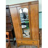 Inlaid mahogany wardrobe inset bevel edged rectangular mirrored door and storage cupboard below