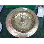 2 ornate circular brass trays,