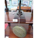 Brass dinner gong on oak plinth