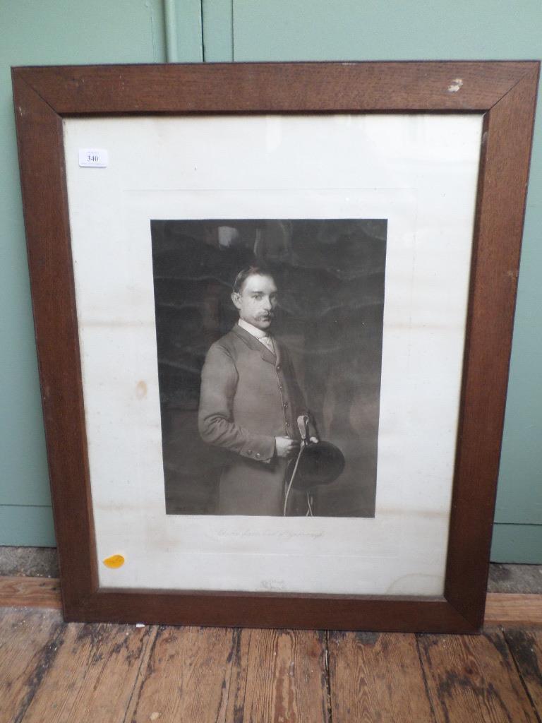Oak framed black and white portrait of Charles,