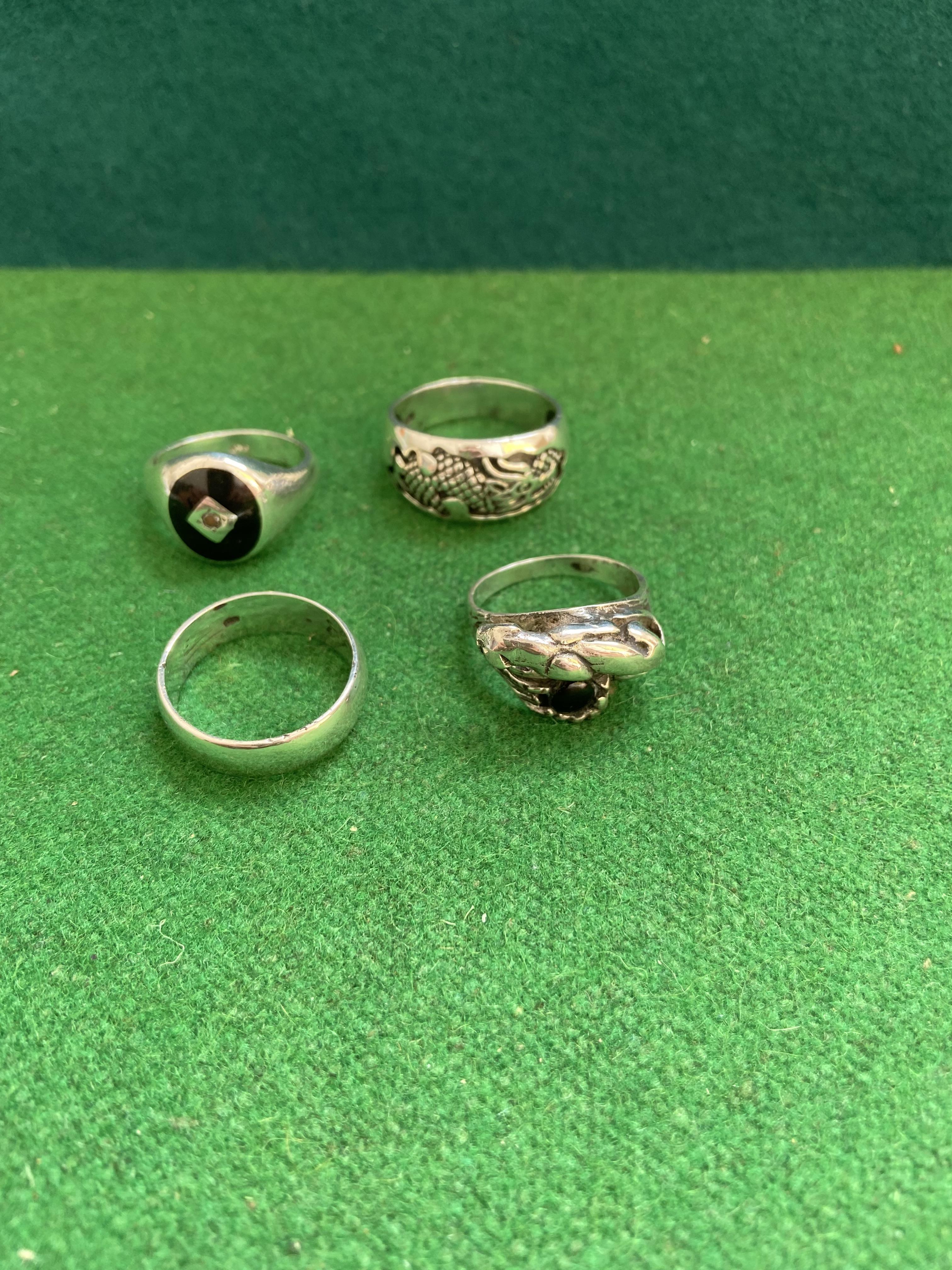 Bag of 4 heavy silver rings