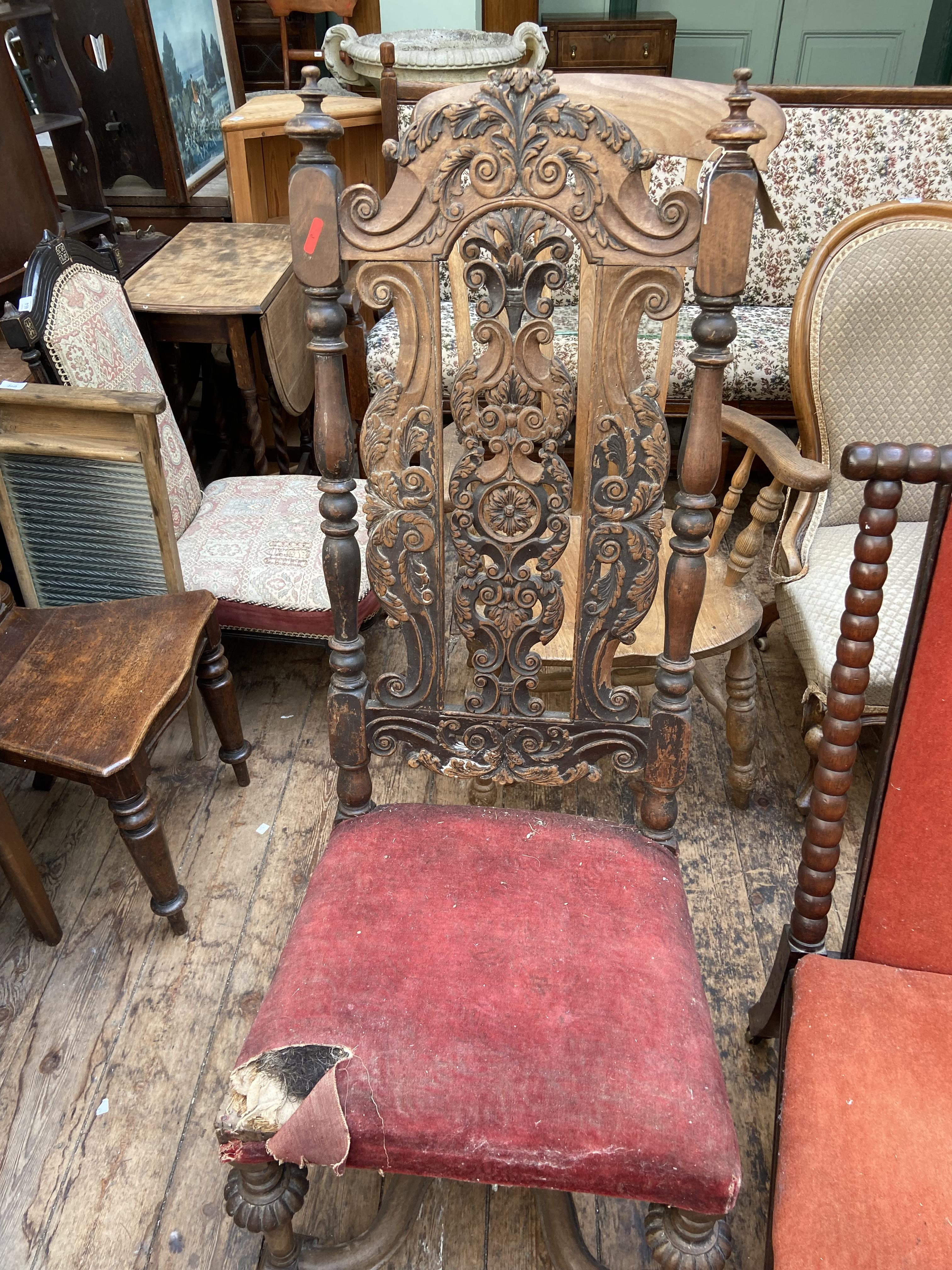 Jacobean style heavily carved high backed dining chair,