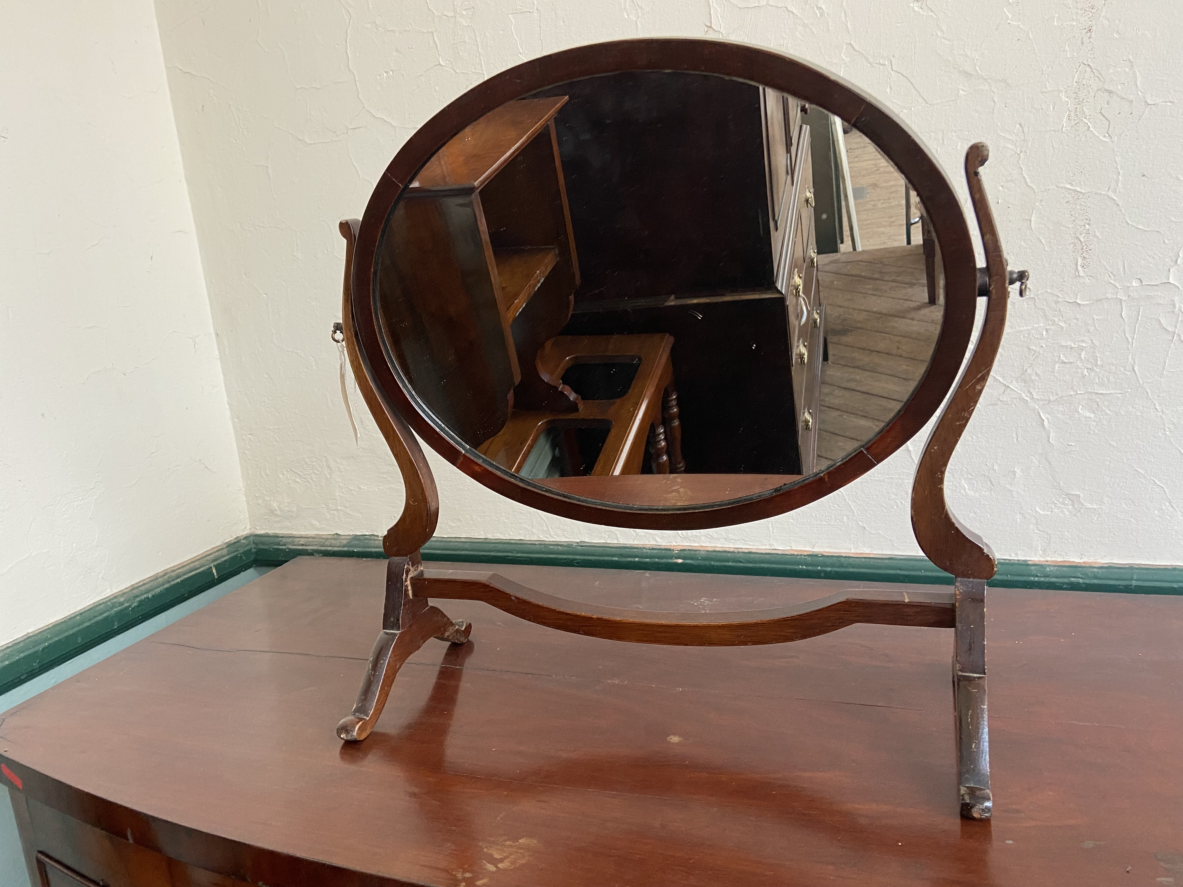 Oval mahogany framed toilet mirror on stand