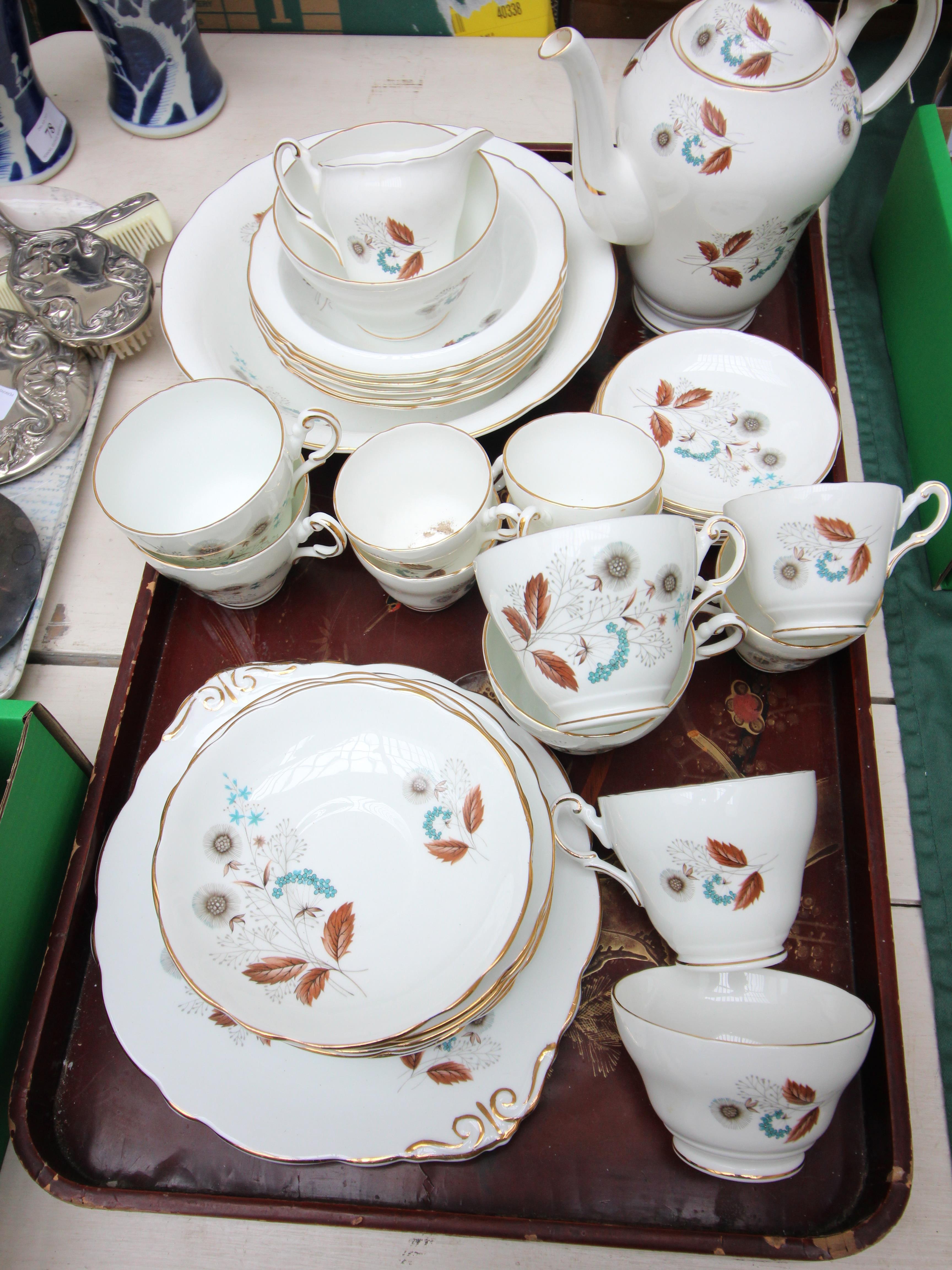 White ground English Regency bone china tea and dessert service decorated autumnal sprays incl.