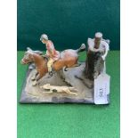 Match striker in the shape of a huntsman on horseback with fox hound at foot
