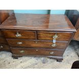 Period oak chest of 2 short and 2 long drawers all with oval brass finger plates and drop handles