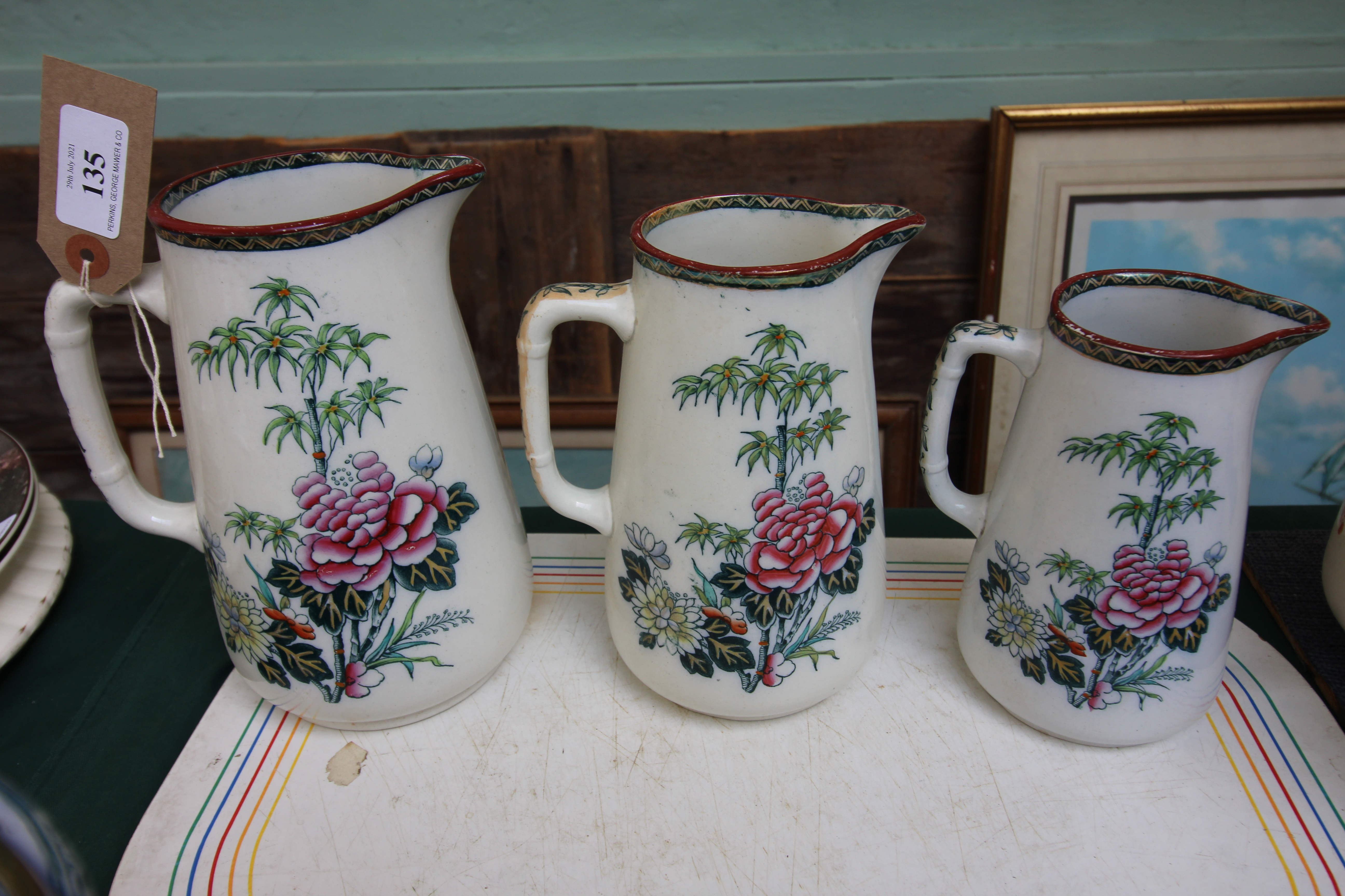 3 Decorative swan china graduated jugs and a further set of three graduated oriental patterned - Image 2 of 2