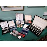 6 individual unused boxes of plated cutlery, cake knives, set of 6 plated napkin rings etc.