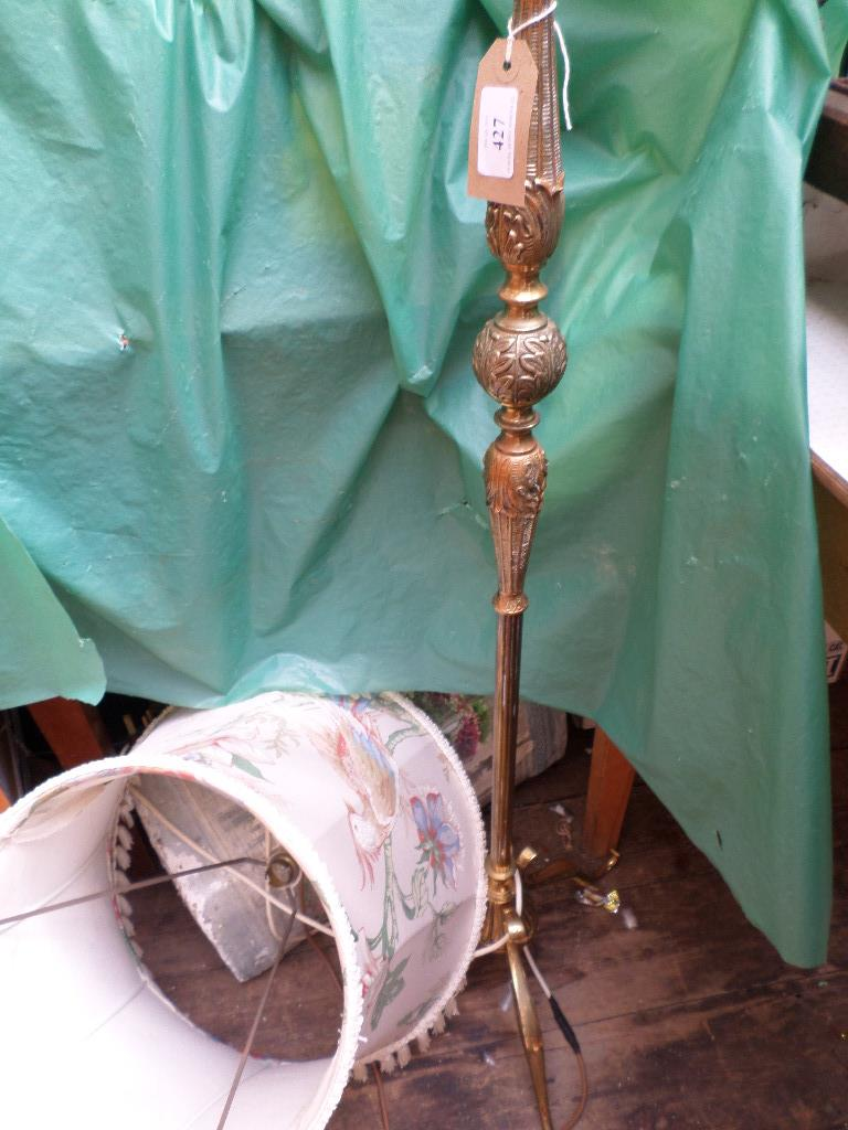 Brass standard lamp with tasselled parchment shade