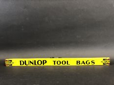 A Dunlop Tool Bags shelf strip in good condition.