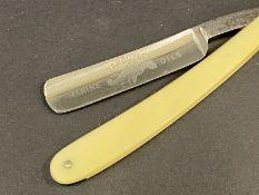 A Gargoyle Marine Oils cut throat razor.