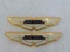 Two David Brown Aston Martin car badges.
