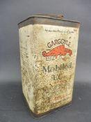 A Mobiloil CC Grade square gallon can.