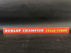 A Dunlop Champion Cycle Tyres shelf strip.