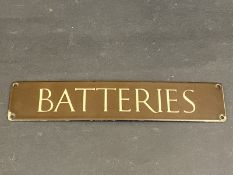 """A small brown and cream coloured enamel sign for 'Batteries', 12 x 2 1/2""""."""