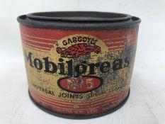A Gargoyle Mobil Grease no. 5 circular tin.