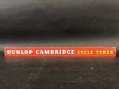 A Dunlop Cambridge Cycle Tyres shelf strip.