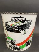 """A waste paper bin decorated with various aspects of motor sport, 7"""" high."""