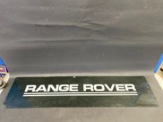 """A Range Rover perspex showroom hanging sign, 48 x 12""""."""
