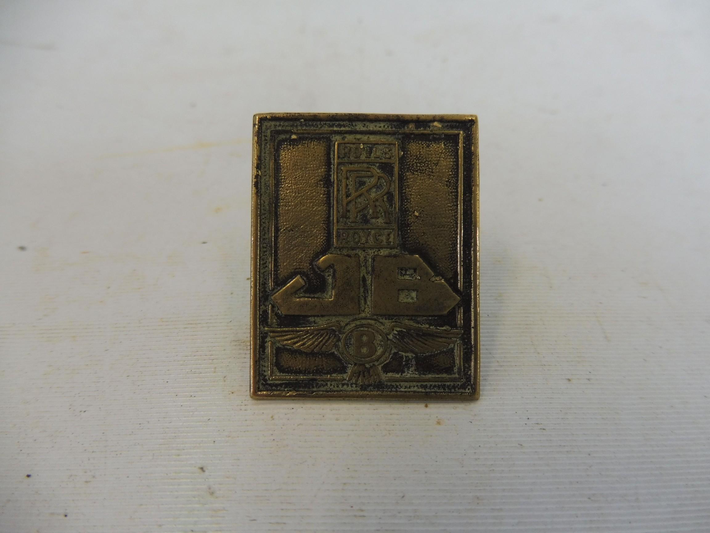 A JB Jack Barclays RR Rolls-Royce brass badge.