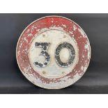 """A cast aluminium 30 MPH circular road sign with 21 reflective discs, 18"""" diameter."""