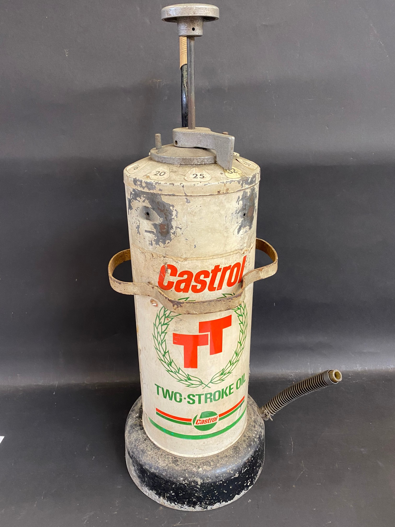 A Castrol TT two stroke and garage forecourt dispenser.