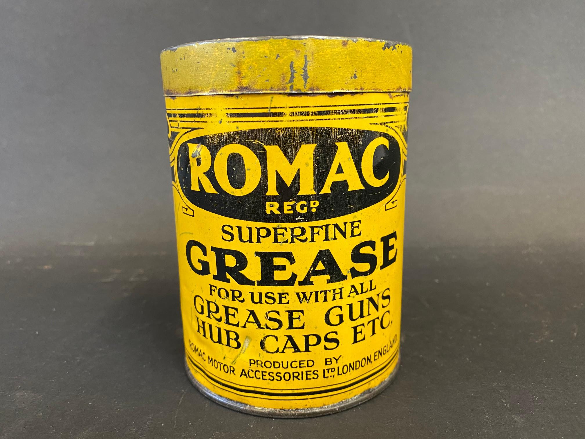 A Romac Superfine Grease tin of bright colour.