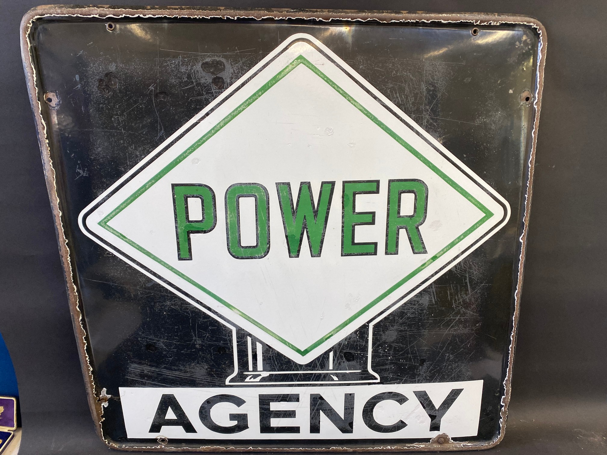 """A Power Agency enamel sign with globe motif to the centre, 35 x 25""""."""