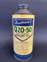A Duckham's Q20-50 Multigrade Engine Oil cylindrical quart can.
