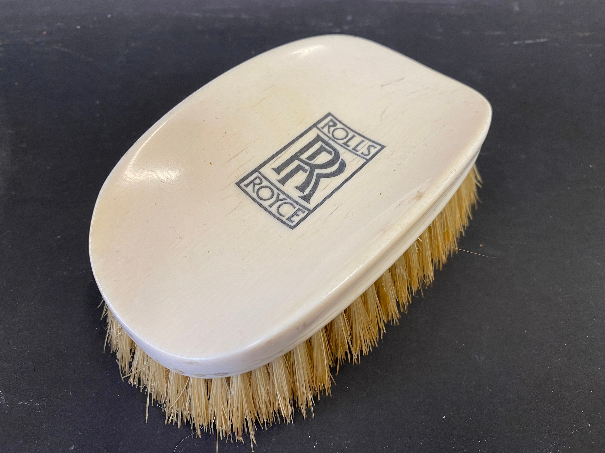 A Rolls-Royce clothes brush, stamped Harrods of London, Made in England.