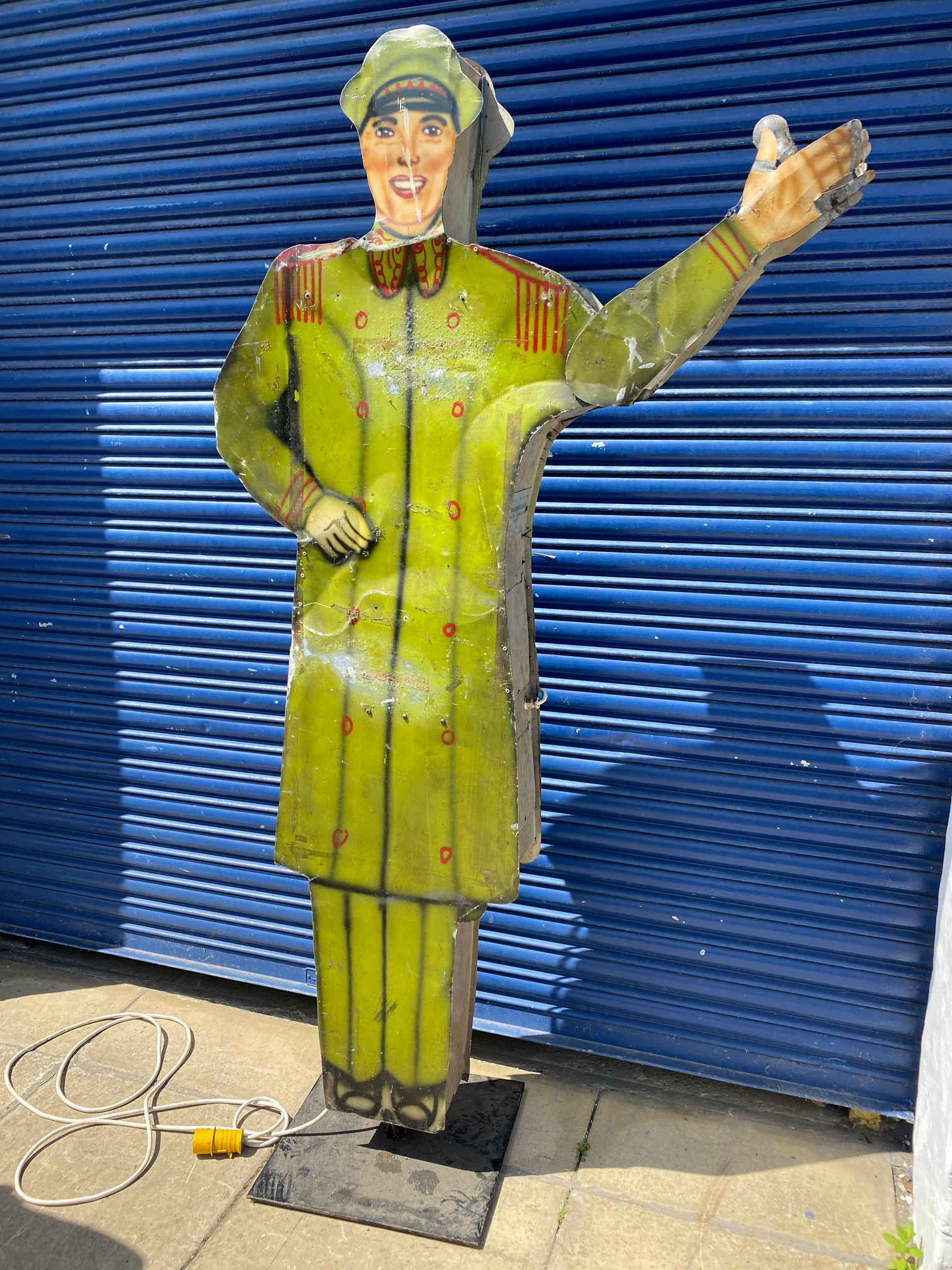 A tall American tin freestanding double sided garage forecourt attendant, with moving arm to draw