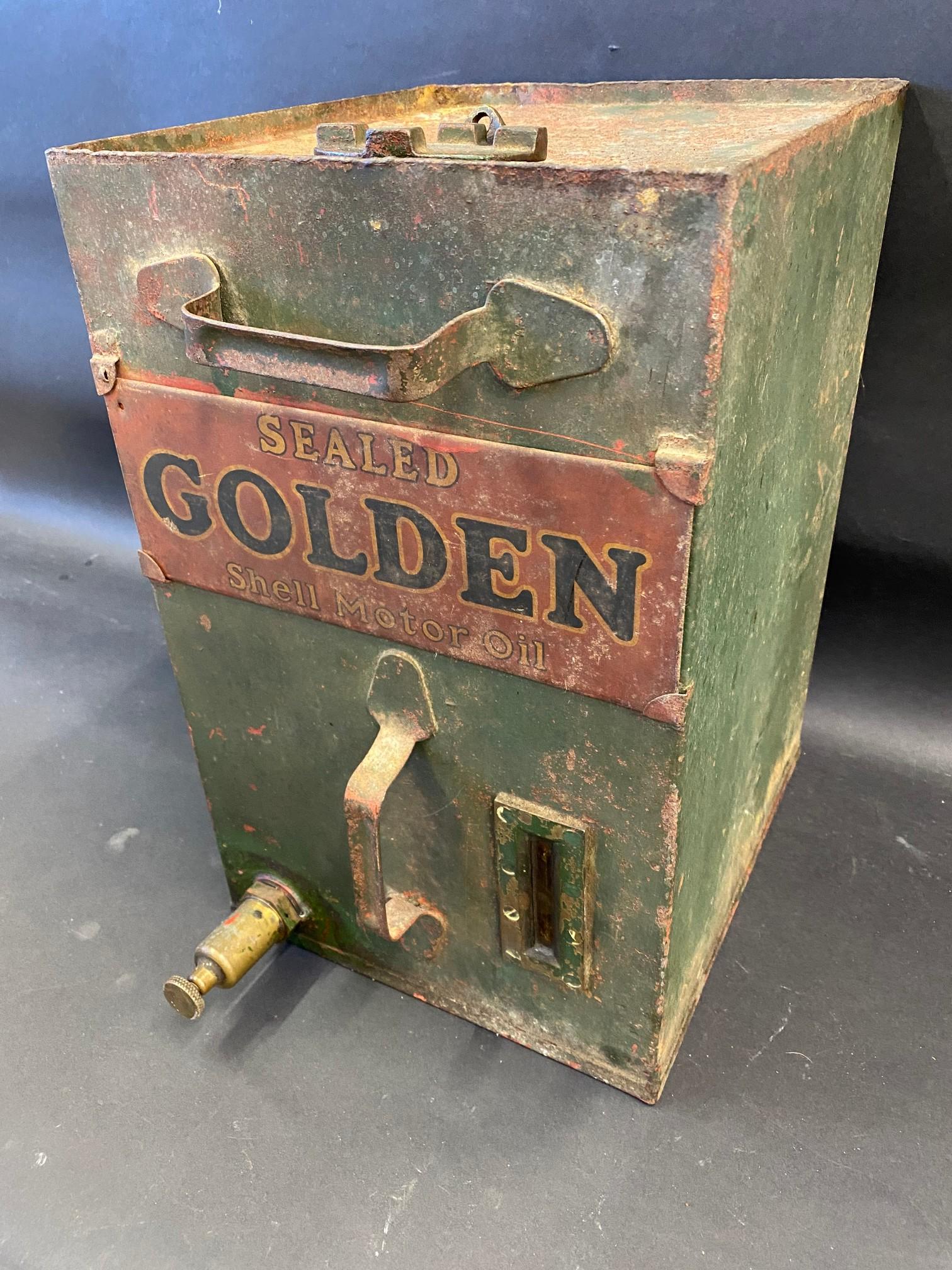 A Sealed Golden Shell motor oil cabinet tank.
