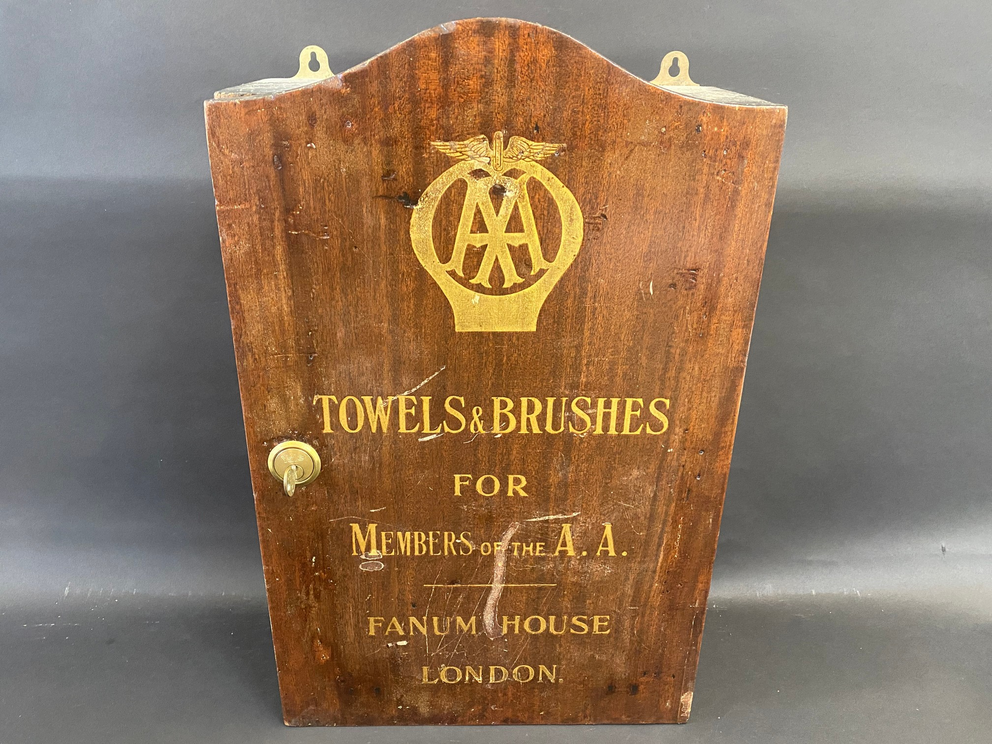 A rarely seen AA wall hanging cupboard containing 'Towels & Brushes for Members of the AA', Fanum