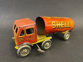 A British clockwork tinplate articulated fuel tanker with Shell-Mex & BP Ltd advertising.