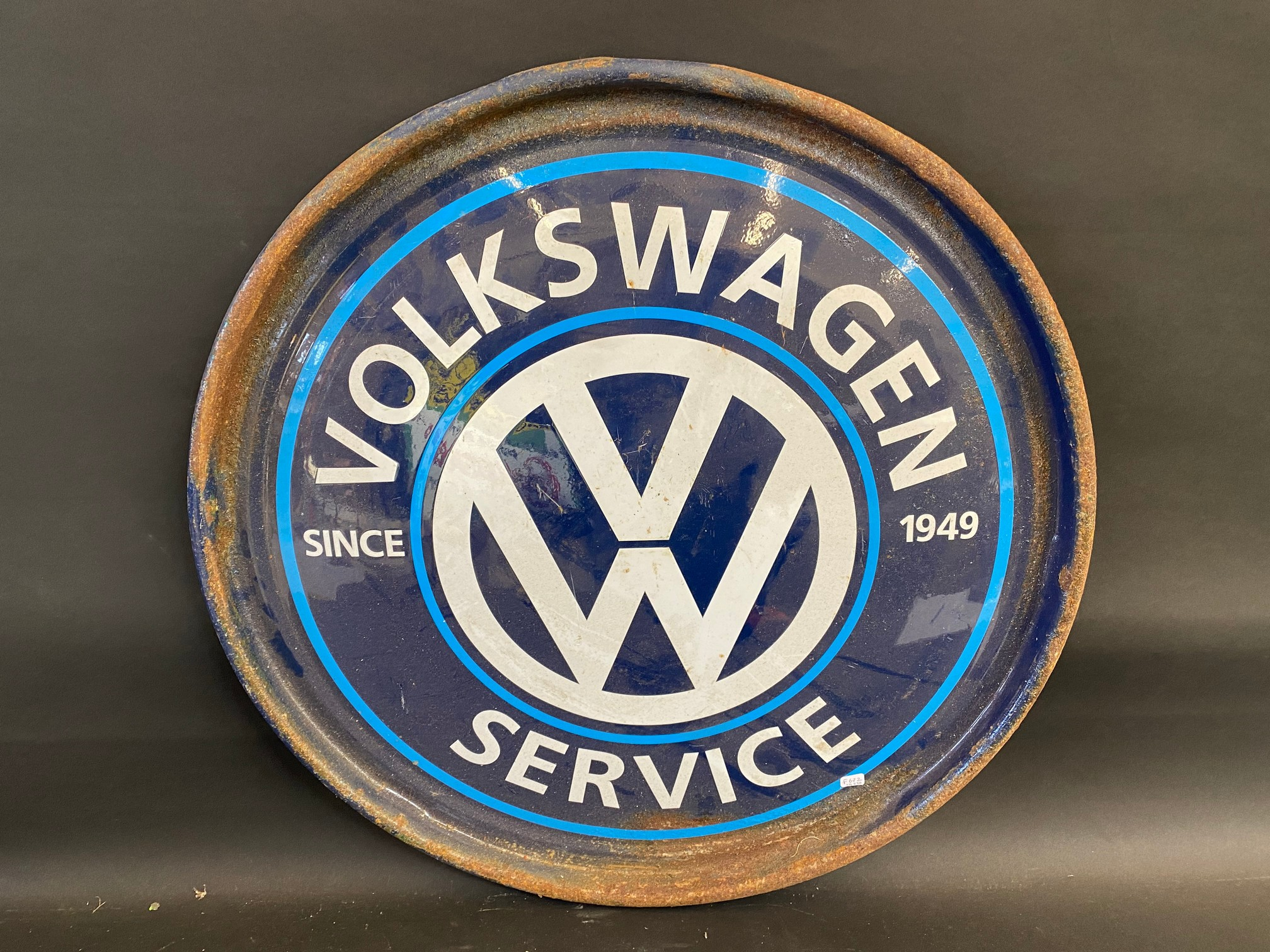 "A contemporary VW Service circular metal sign, 24"" diameter."