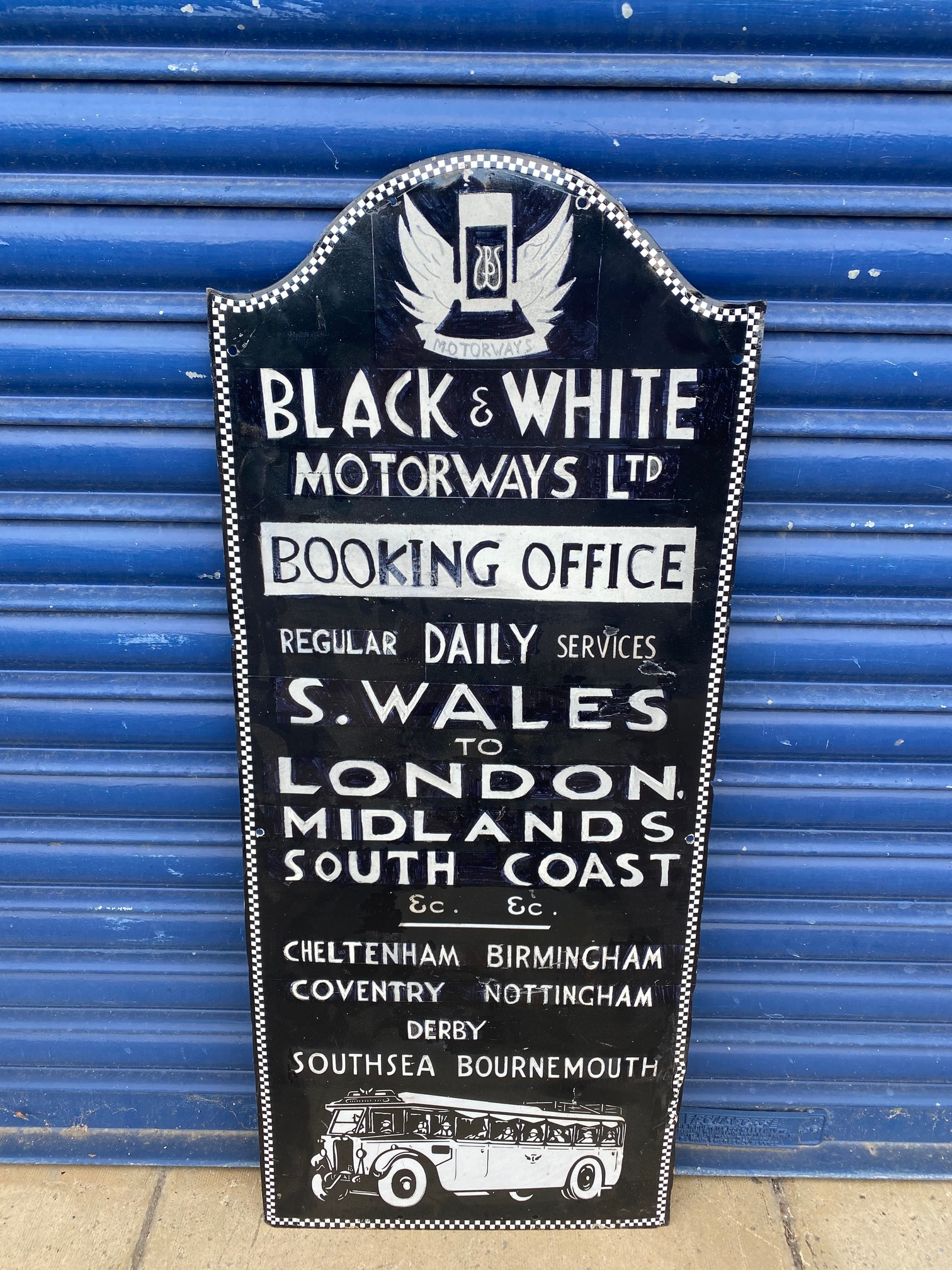 A Black and White Motorways Ltd Booking Office part pictorial enamel sign, heavily restored.