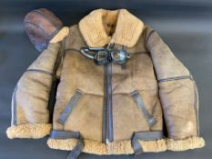 An Irvin flying jacket size 40 in very good condition with matching hat and goggles.