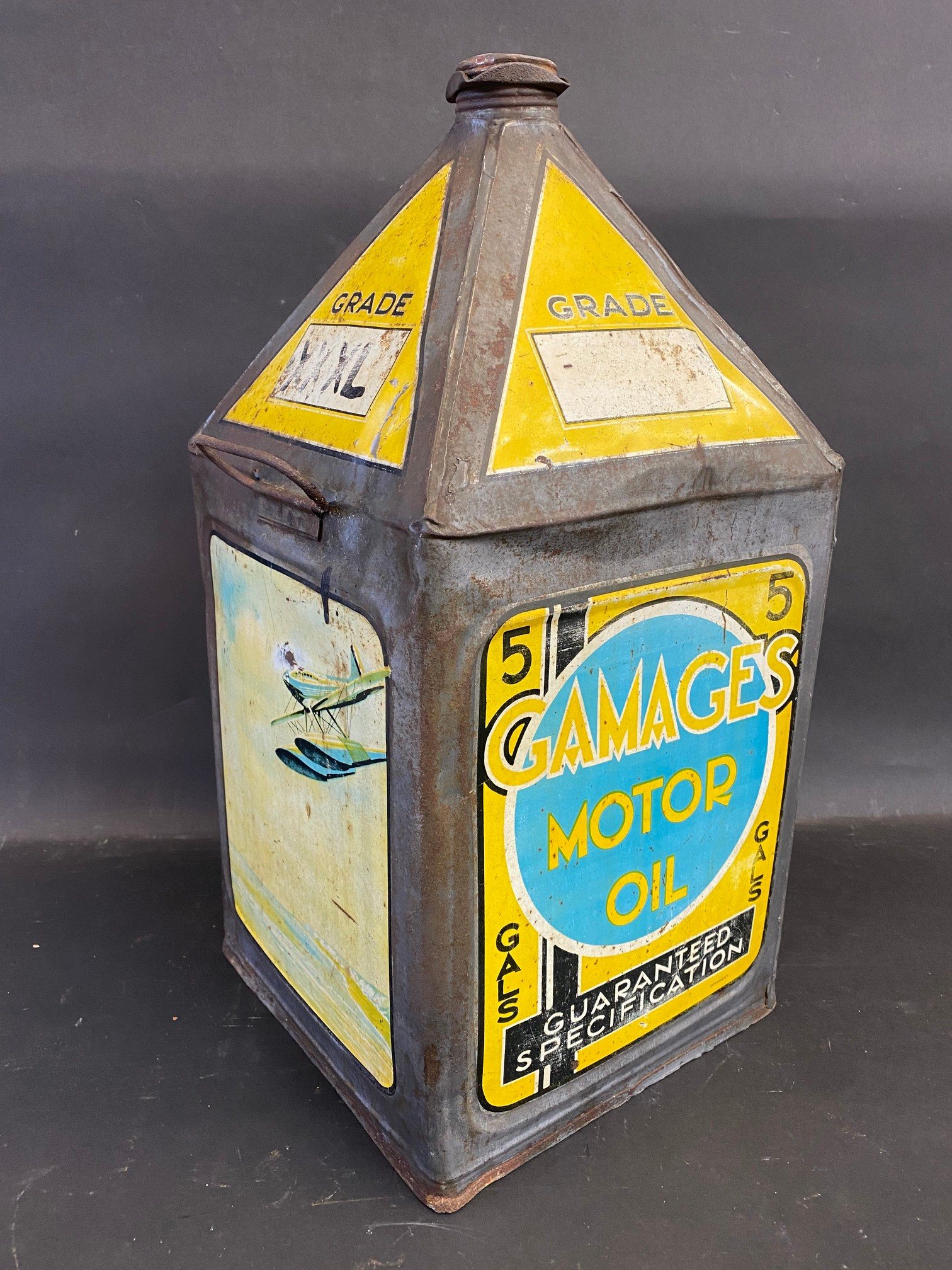A Gamages Motor Oil five gallon pyramid can of good colour.