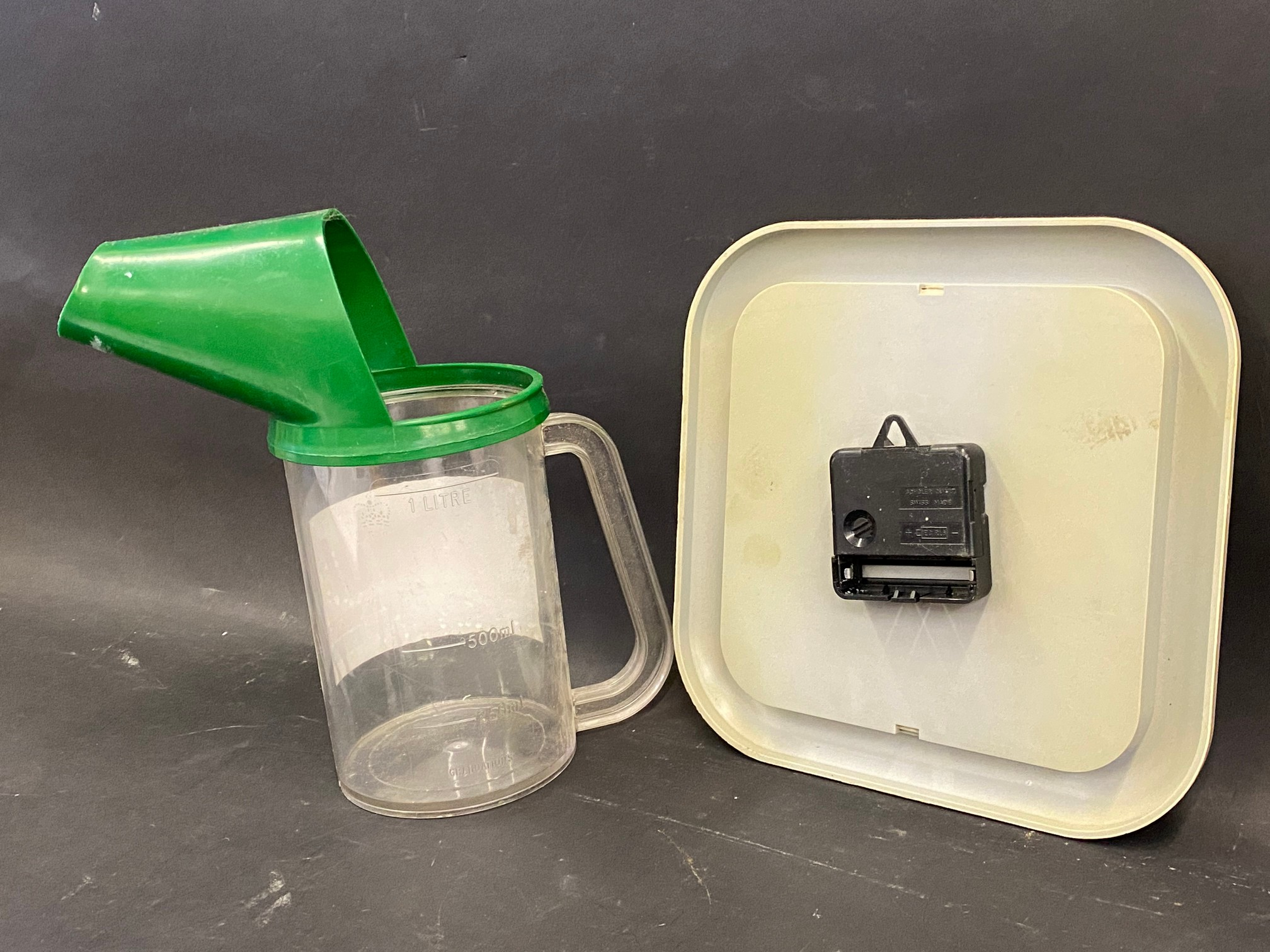 A Castrol one litre plastic measure and a Castrol TXT battery operated wall clock. - Image 2 of 2