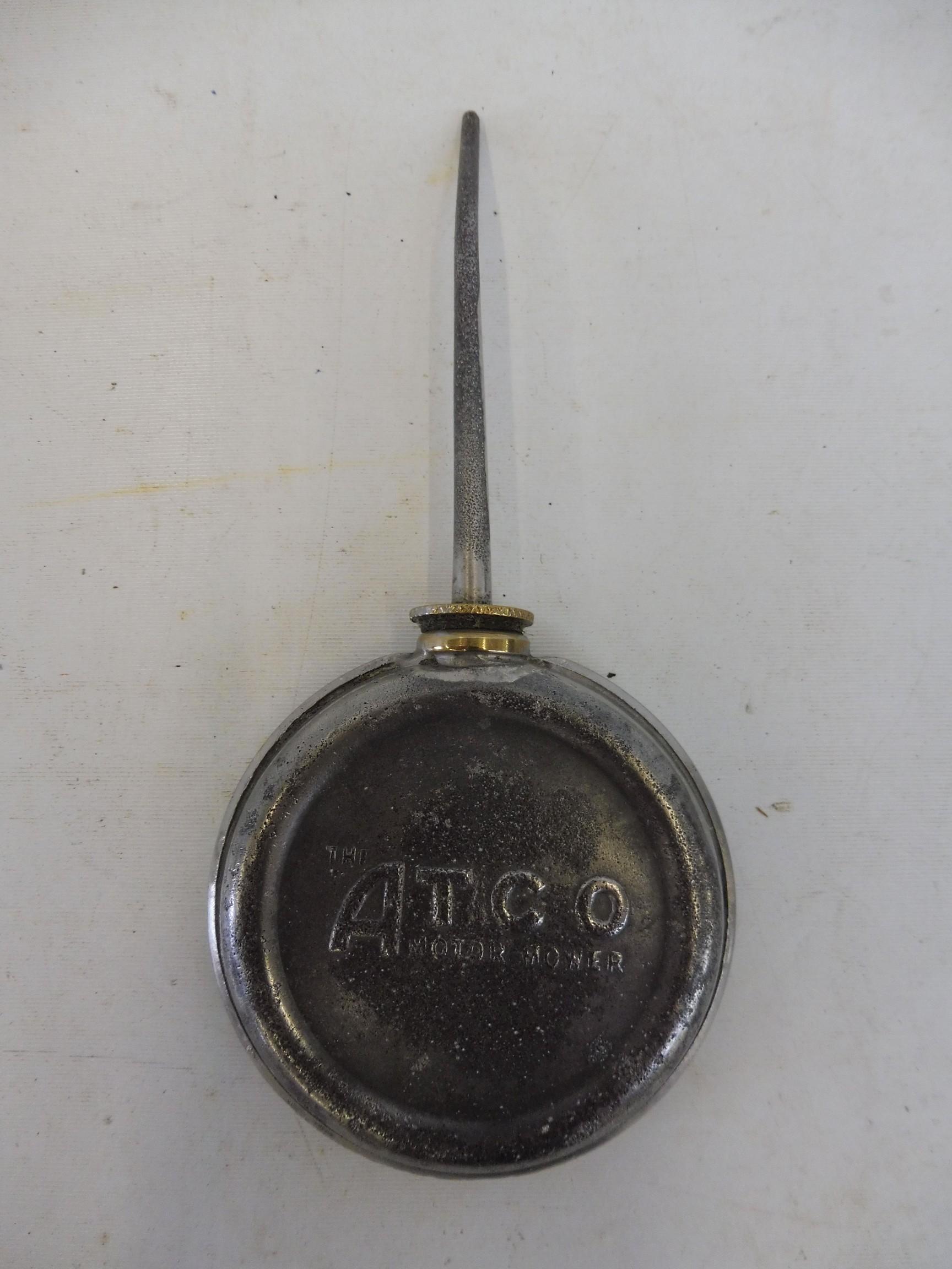 An Atco motor mower oiler/oil can.