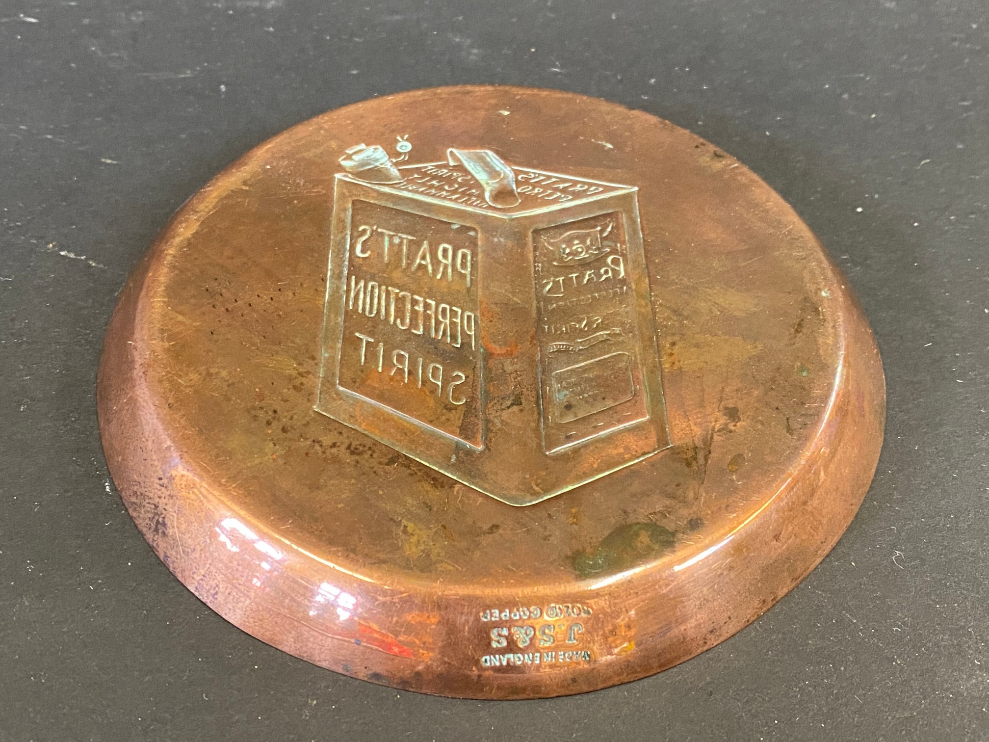 A copper ashtray advertising Pratt's Perfection Spirit, stamped J.S&S. - Image 2 of 2