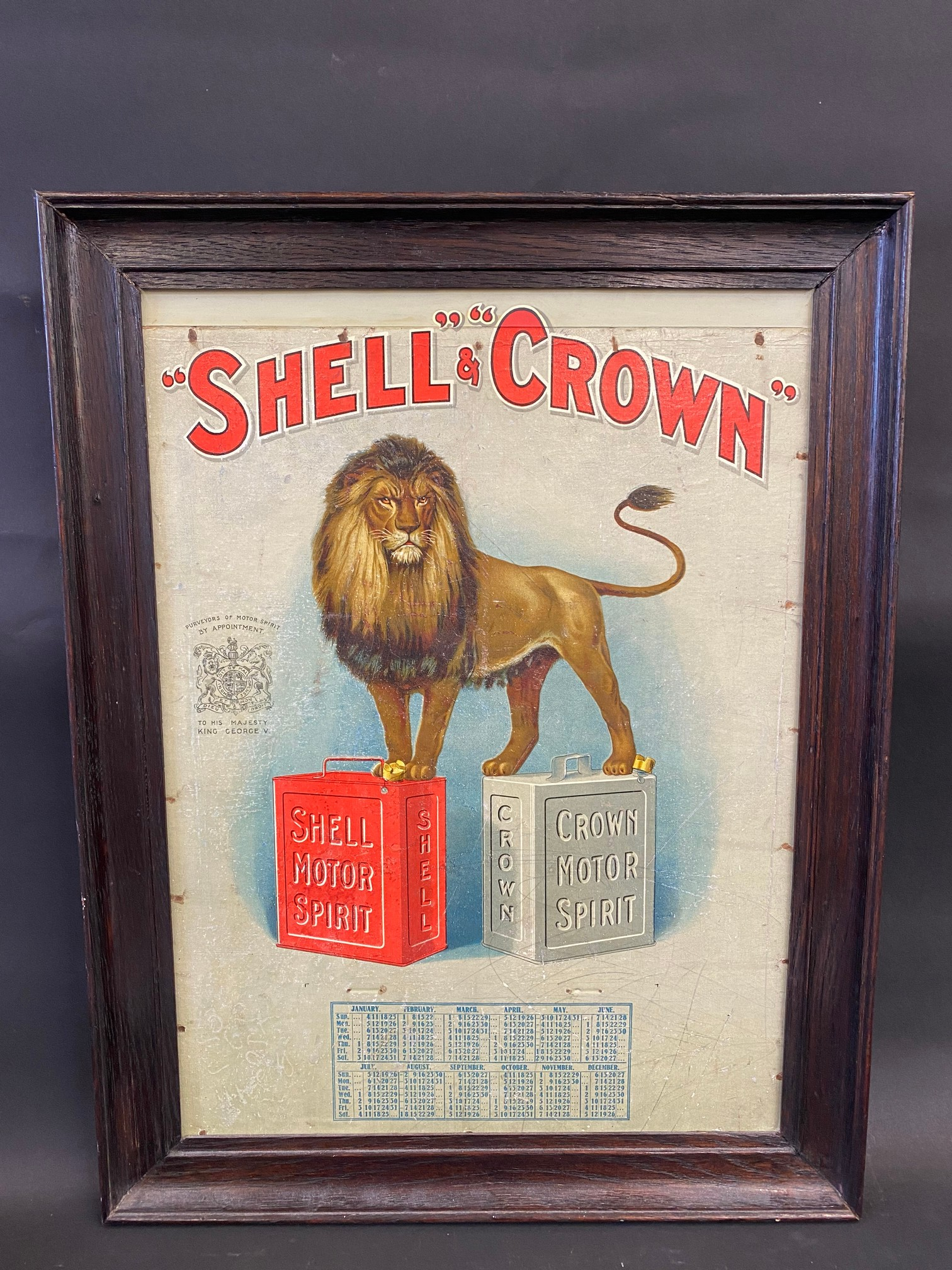 A very rare Shell and Crown Motor Spirit pictorial showcard depicting a lion stood astride a pair of
