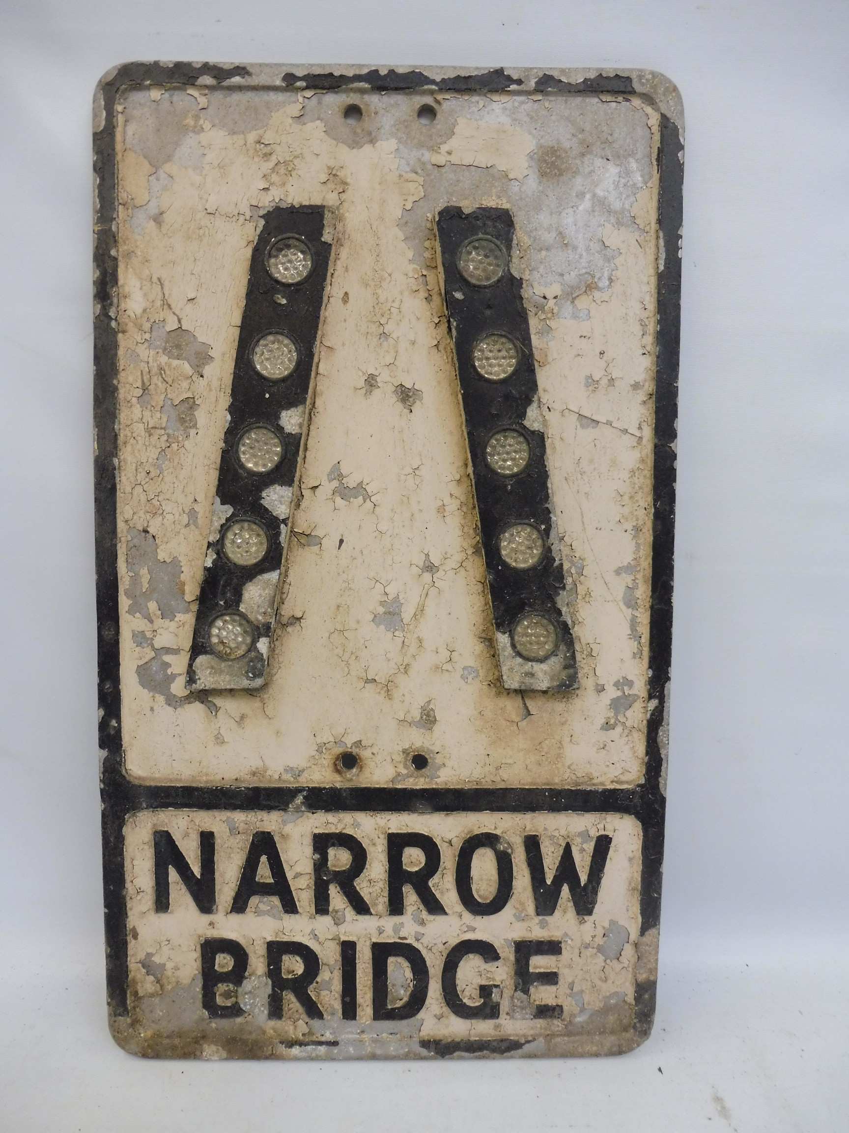 "An aluminum road sign - Narrow Bridge with glass reflective discs, 12 x 21""."