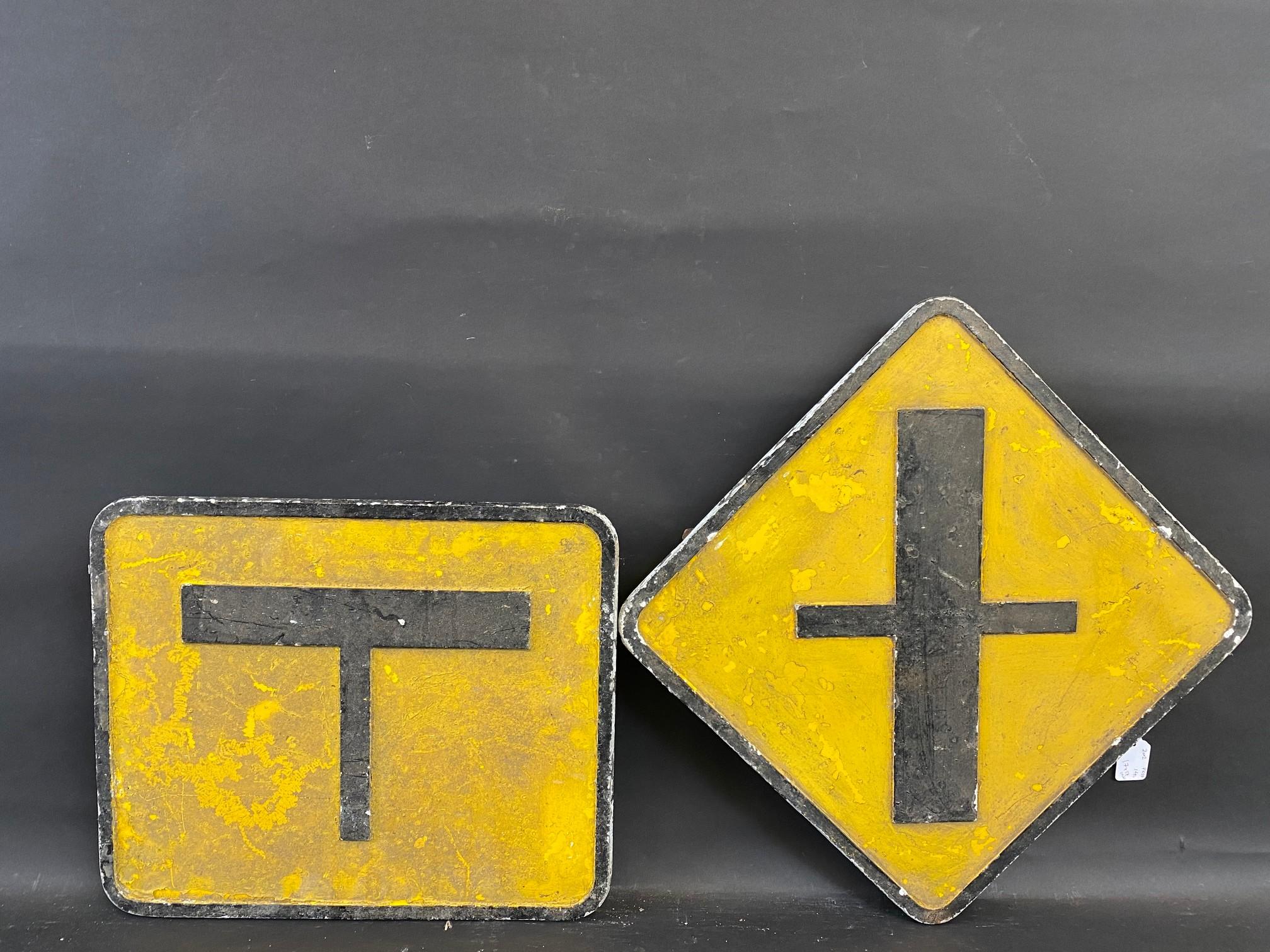 "Two cast aluminium Irish road signs, T junction (18 x 15"") and Cross Roads (23 x 23"")."