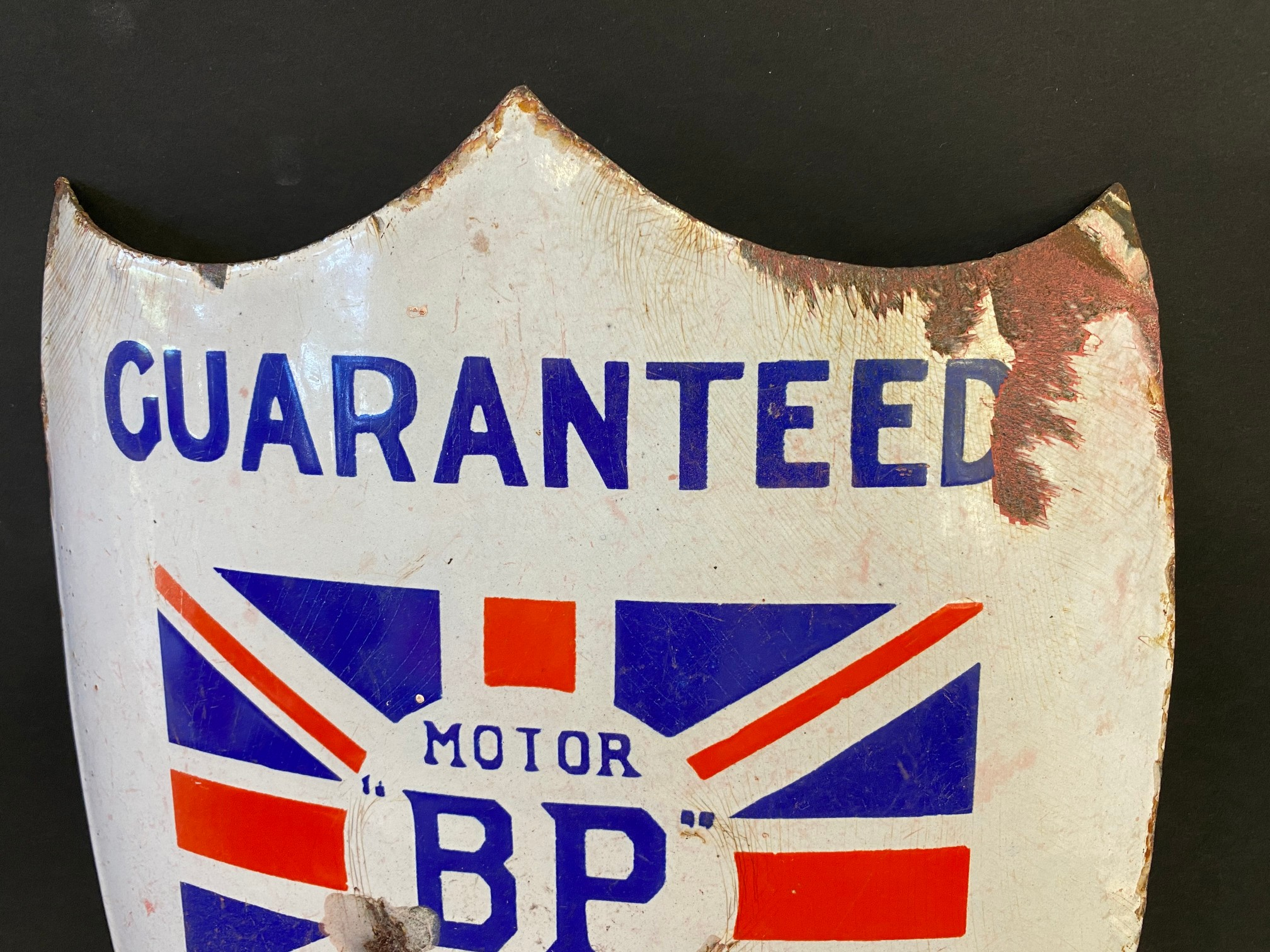 A BP Motor Spirit 'Guaranteed No. 1' shield shaped curved enamel sign with central union jack, 9 x - Image 3 of 4