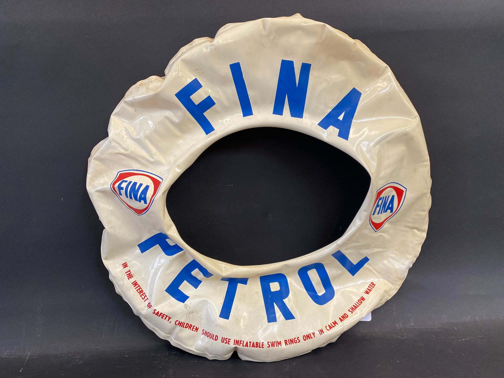 An inflatable swim ring advertising Fina Petrol.