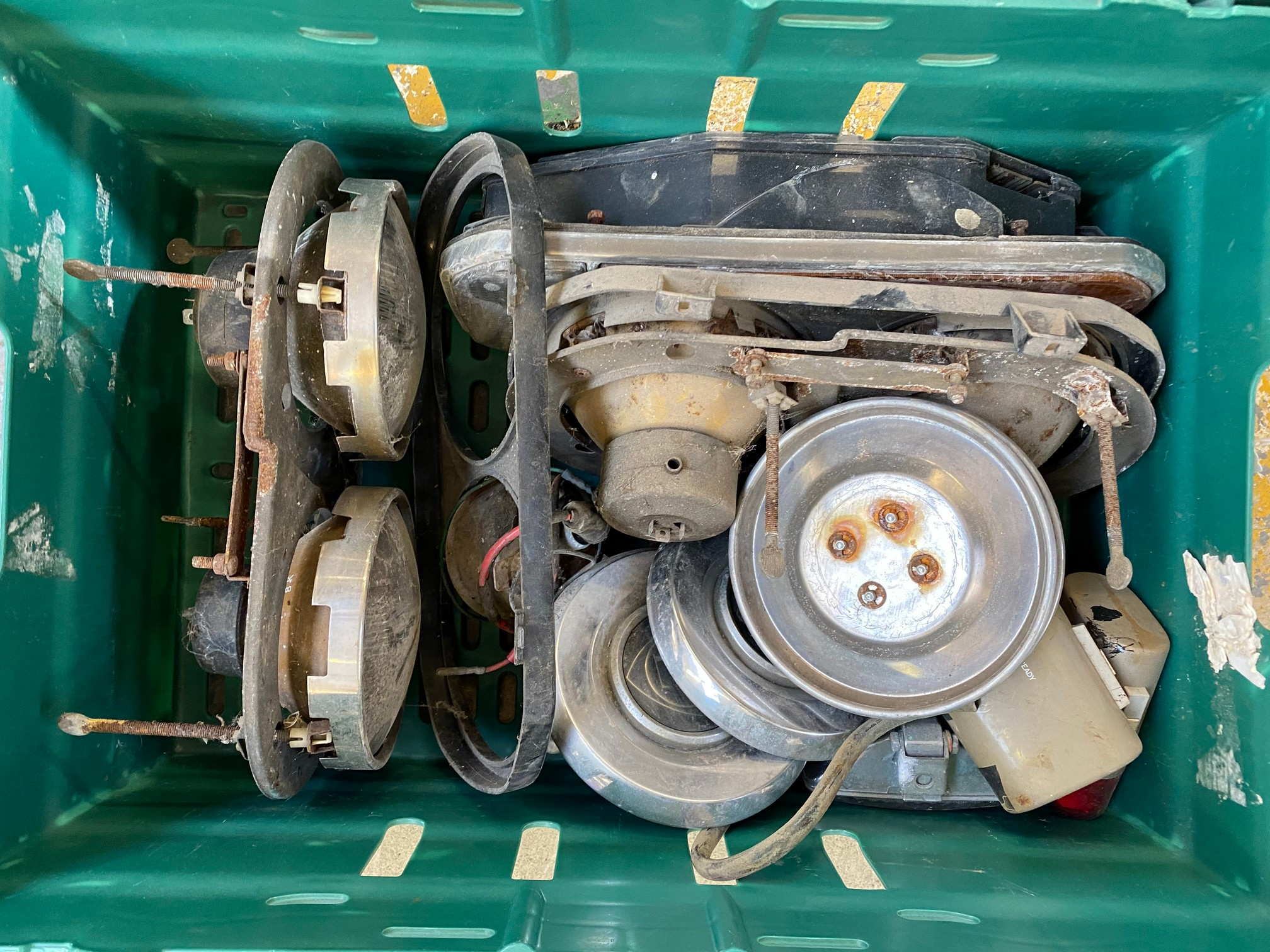 A box of Lancia spares including light clusters etc.