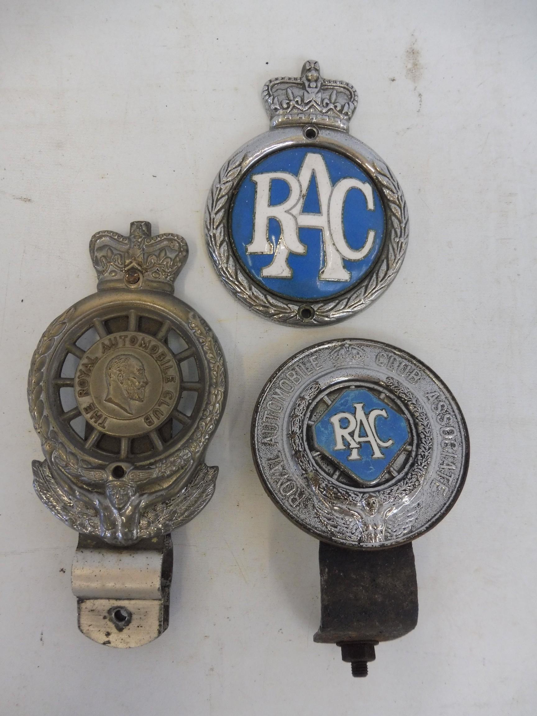 Three early RAC car badges.